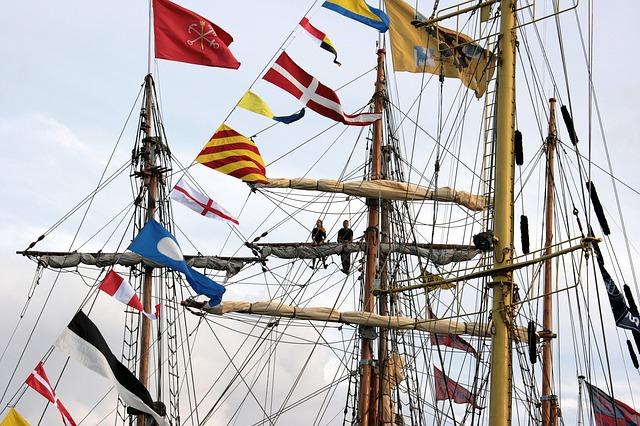 A sailing ship displaying signal flags