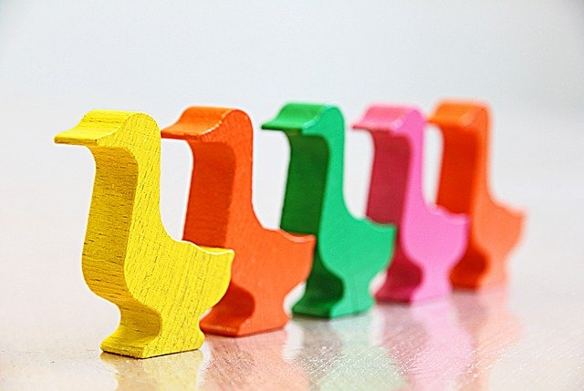 A series of coloured wooden ducks used to illustrate sequences and queues
